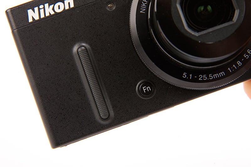 Nikon COOLPIX P330 Review -front plate Fn / grip