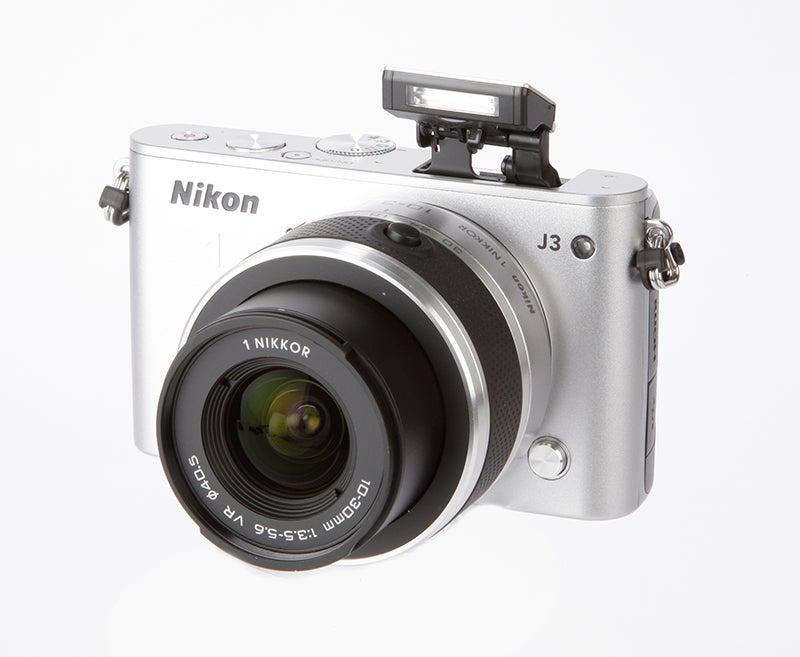 Nikon 1 J3 Review - front w/ flash