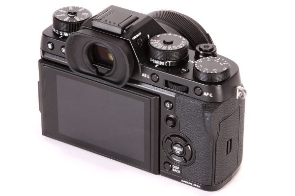 In this view you can see the drive and metering mode levers, beneath the ISO and shutter speed dials