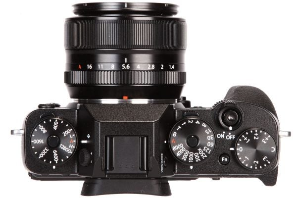 The top-plate hosts ISO, shutter speed and exposure compensation dials